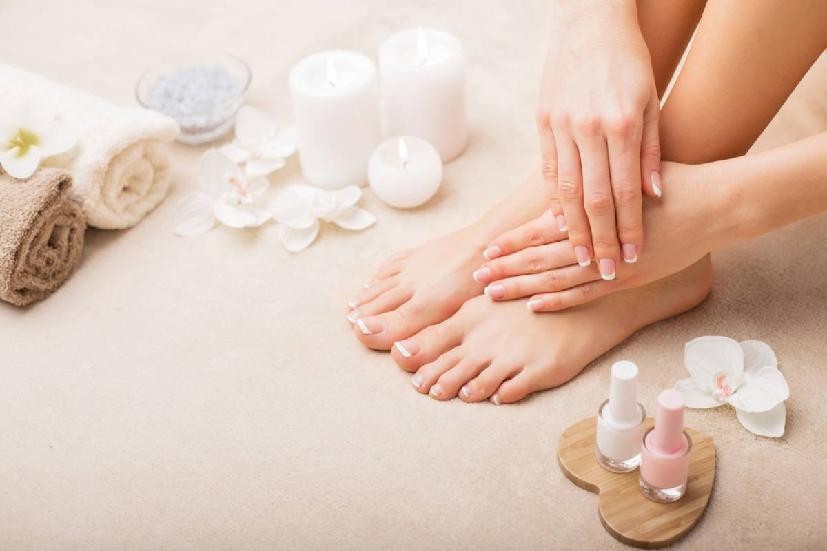 Woman doing basic foot care with creams and candles.