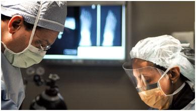 surgeon at work on operating stock photo