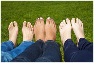 Legs of three persons stock photo